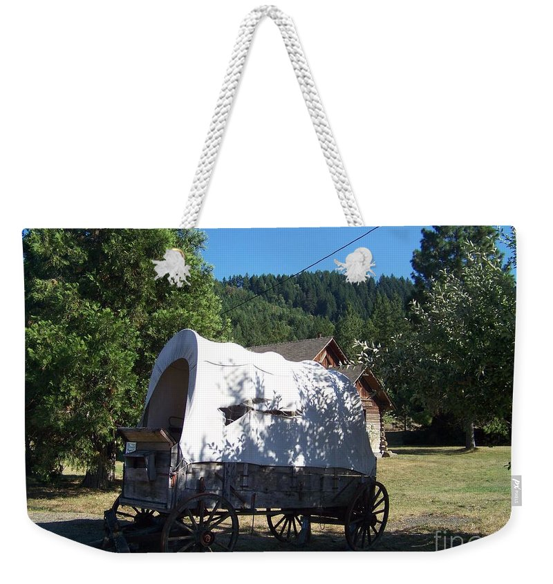 Covered Wagon Weekender Tote Bag featuring the photograph The Last Leg In Color by Charles Robinson
