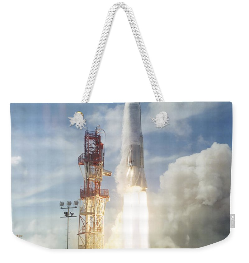 1961 Weekender Tote Bag featuring the photograph The Launch Of The Mercury-atlas 4 by Stocktrek Images