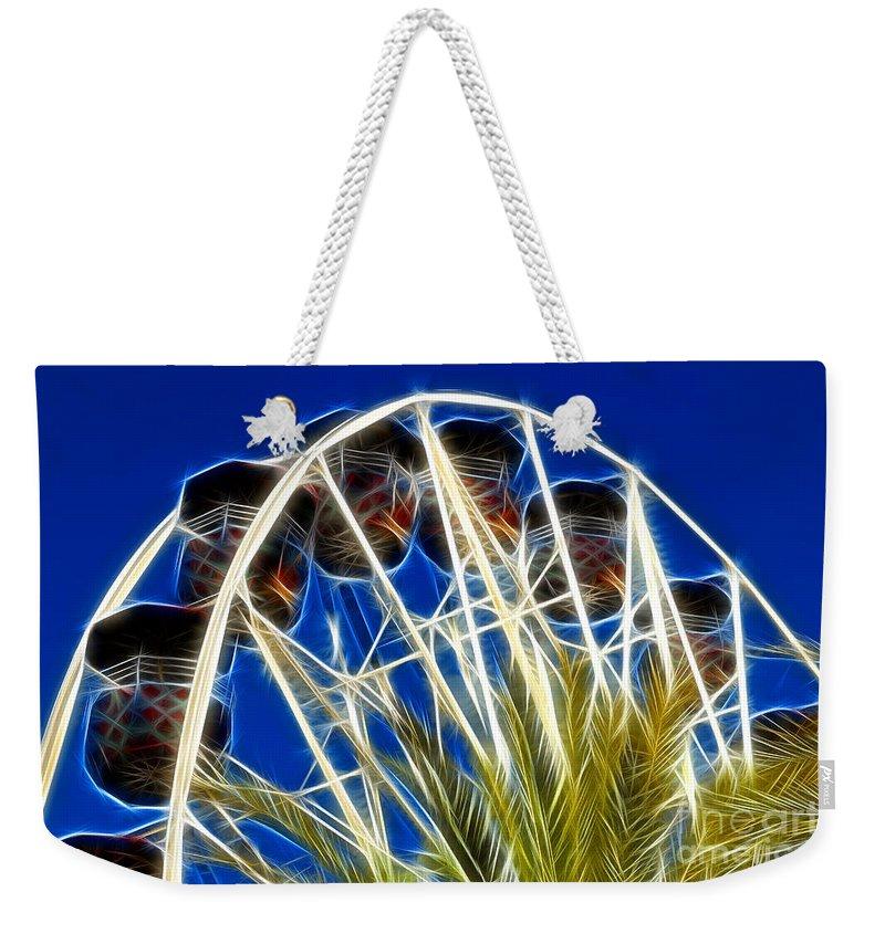 The Magic Ferris Wheel Ride Weekender Tote Bag featuring the digital art The Magic Ferris Wheel Ride by Mariola Bitner