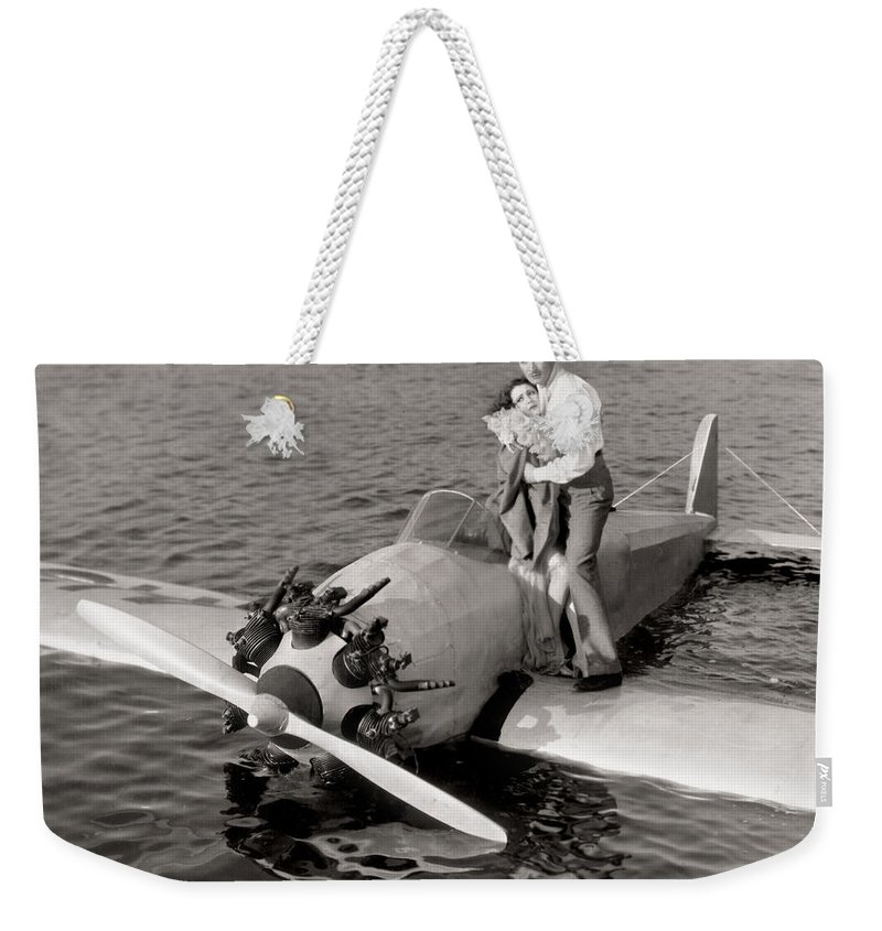 -transportation: Misc- Weekender Tote Bag featuring the photograph The Man And The Moment by Granger
