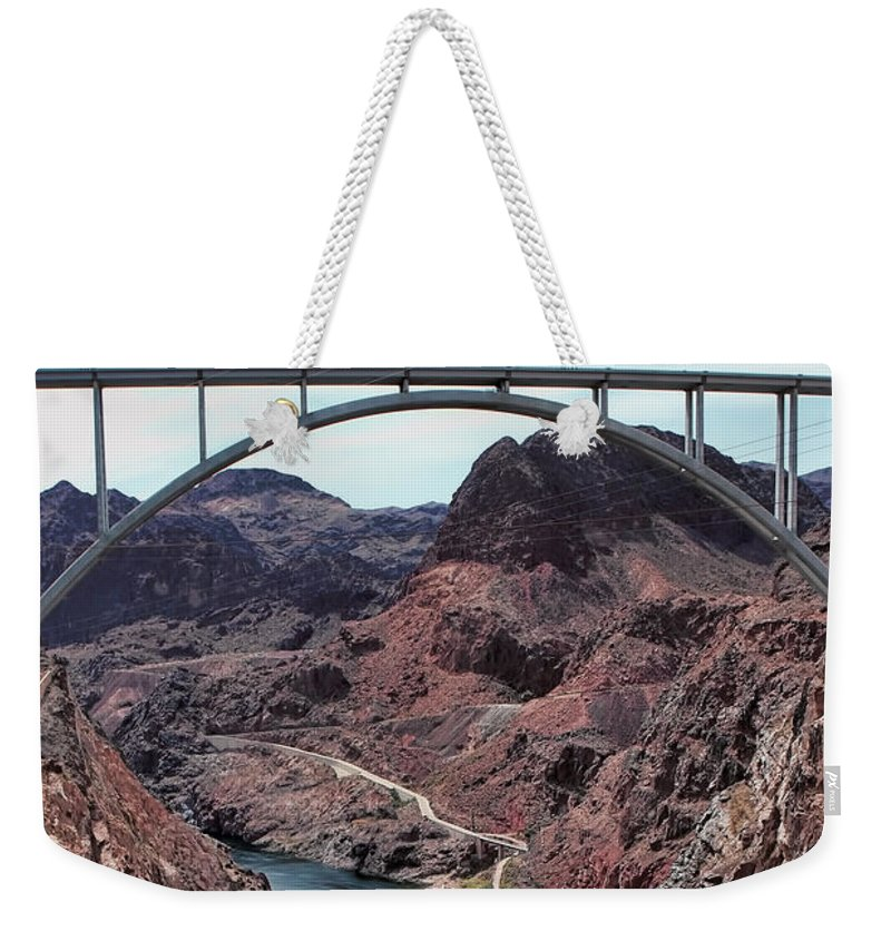 The Hoover Dam Weekender Tote Bag featuring the photograph The Pat Tillman Memorial Bridge by Tom Prendergast