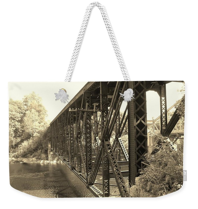 Steel Bridge Weekender Tote Bag featuring the photograph The Retired Railroad Bridge by Sherman Perry