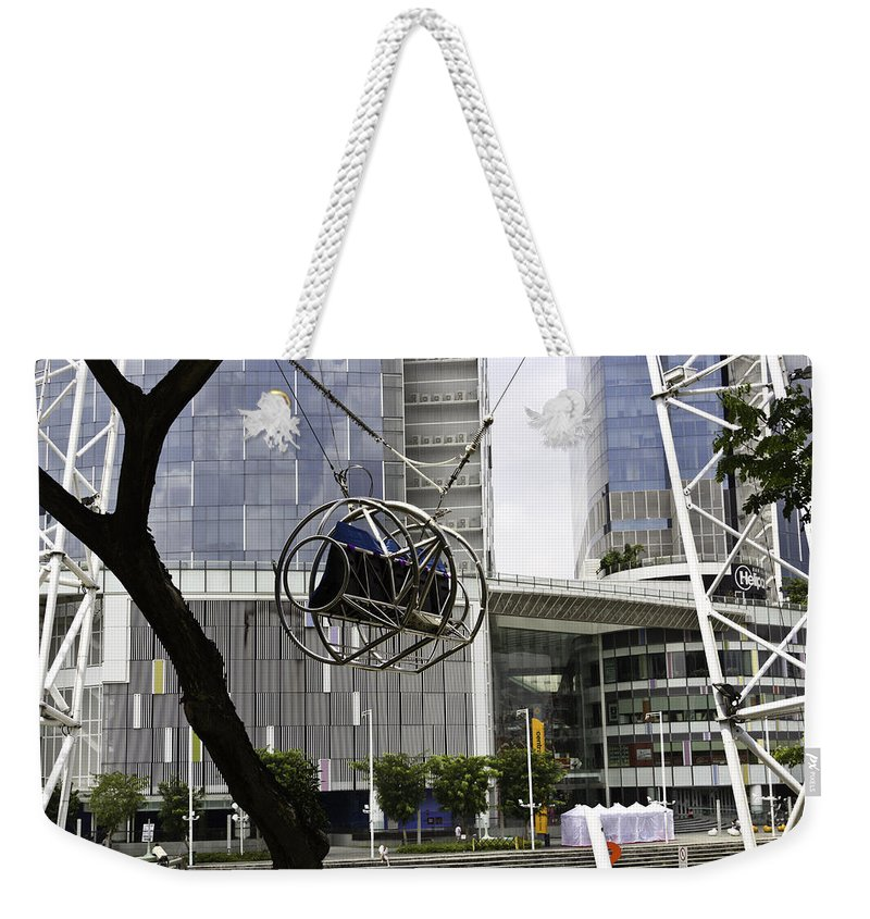 Action Weekender Tote Bag featuring the photograph The Seat Of The G-max Reverse Bungee At The Clarke Quay In Singapore by Ashish Agarwal
