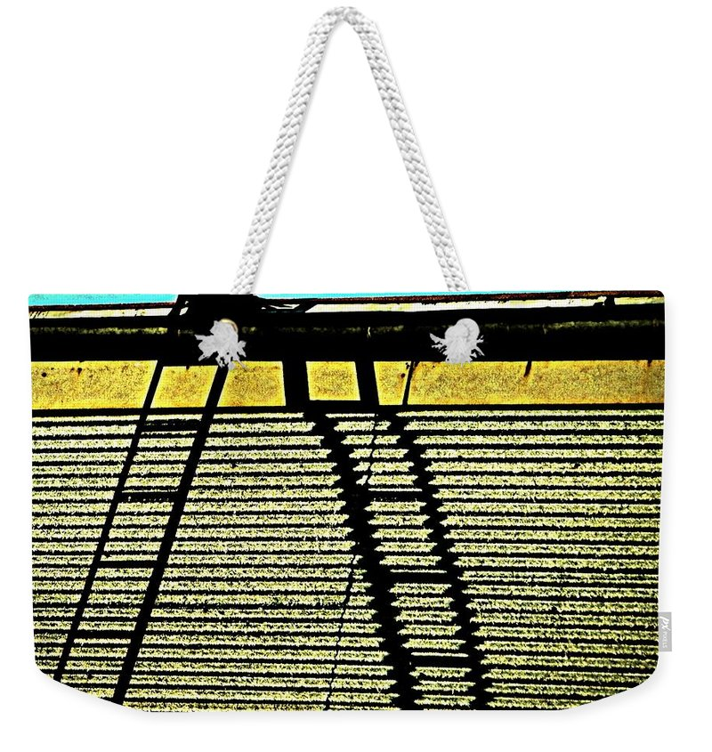 Urban Weekender Tote Bag featuring the photograph The Sky Is The Limit by Chris Berry