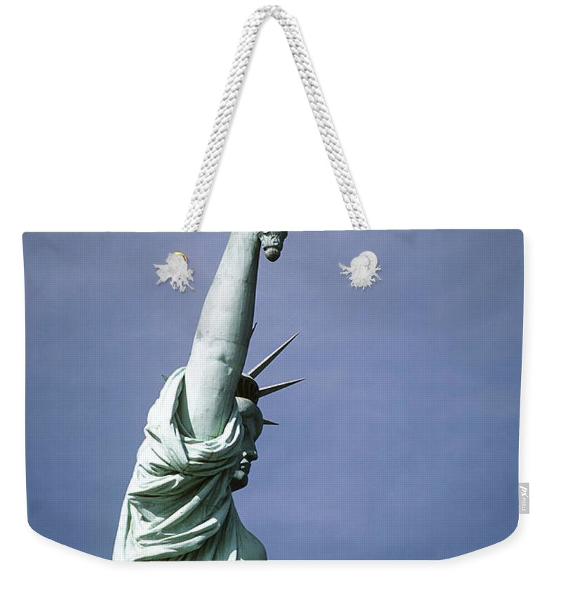 Symbolic Weekender Tote Bag featuring the photograph The Statue Of Liberty by Stocktrek Images