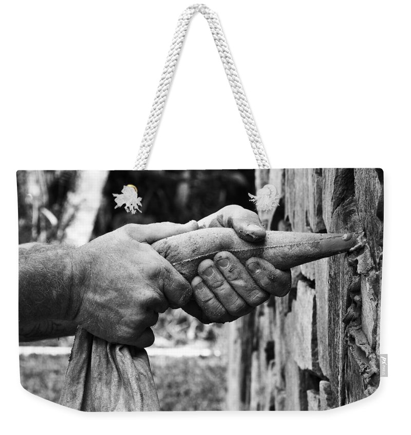 Stone Mason Weekender Tote Bag featuring the photograph The Stone Mason by Christine Stonebridge
