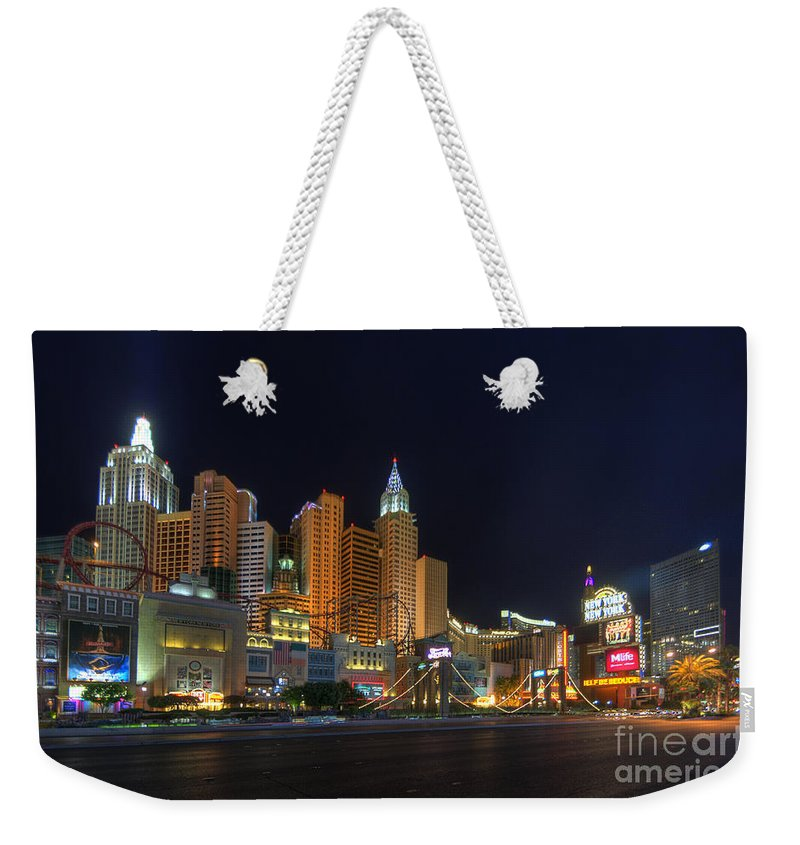 Art Weekender Tote Bag featuring the photograph The Strip by Yhun Suarez