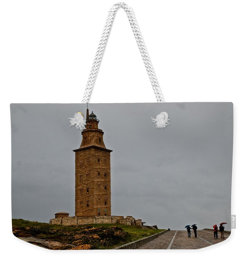 A Coruna Weekender Tote Bag featuring the photograph The Tower Of Hercules by Eric Tressler