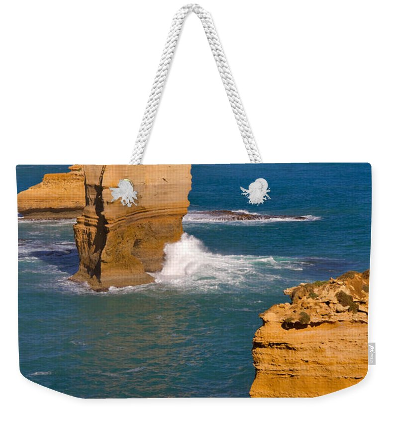 Twelve Apostles Weekender Tote Bag featuring the photograph The Twelve Apostles In Port Campbell National Park Australia by Louise Heusinkveld