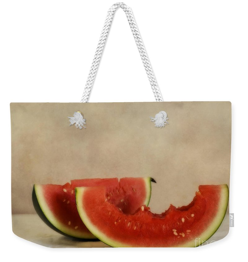 2 Weekender Tote Bag featuring the photograph Three Bites Of Summer by Priska Wettstein