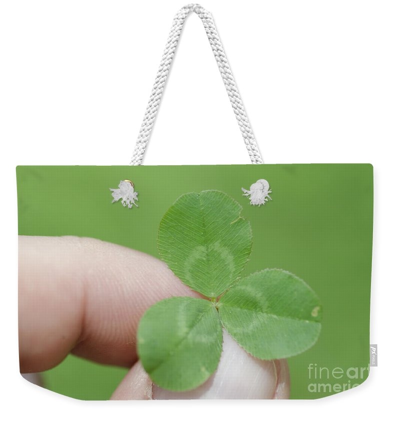 Three Leaf Clover Weekender Tote Bag featuring the photograph Three Leaf Clover In A Hand by Mats Silvan