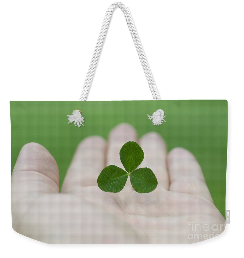 Three Leaf Clover Weekender Tote Bag featuring the photograph Three Leaf Clover by Mats Silvan