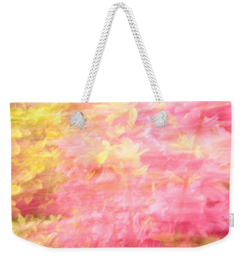 Flowers Weekender Tote Bag featuring the photograph Thru The Breeze by Karol Livote