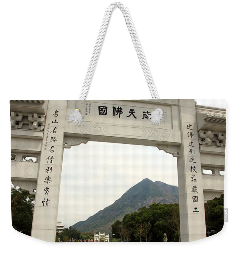 Bronze Weekender Tote Bag featuring the photograph Tian Tan Buddha Entrance Arch by Valentino Visentini