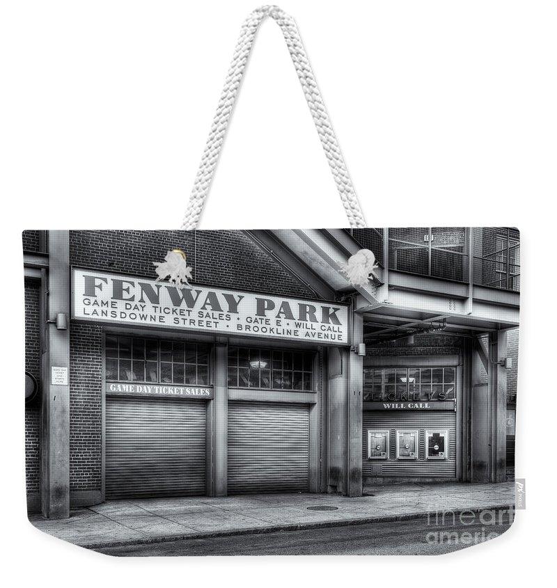 Clarence Holmes Weekender Tote Bag featuring the photograph Ticket Windows II by Clarence Holmes