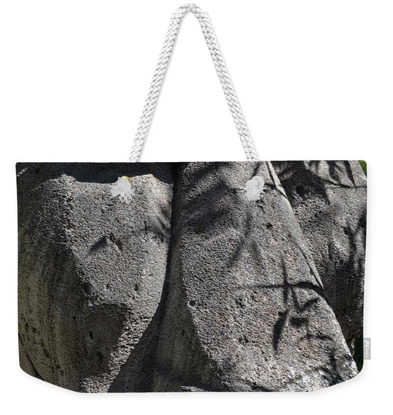 Tiki Weekender Tote Bag featuring the photograph Tiki In Shade by Bill Owen
