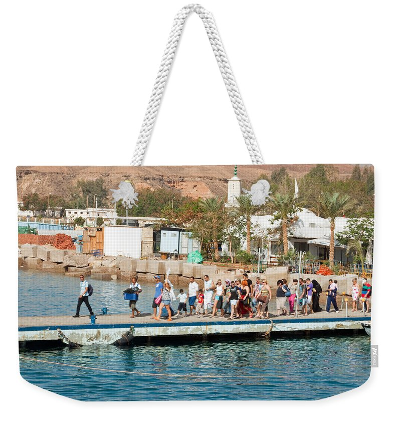 Sharm El Sheikh Weekender Tote Bag featuring the photograph Tourists Waiting To Climb Onto Dive And Snorkeling Boats At Sharm El Sheikh by Ashish Agarwal