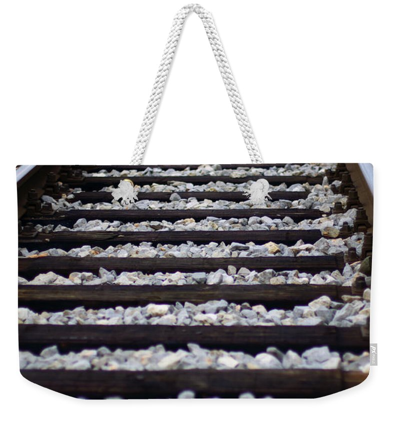 Track Weekender Tote Bag featuring the photograph Tracks by Ivan Slosar