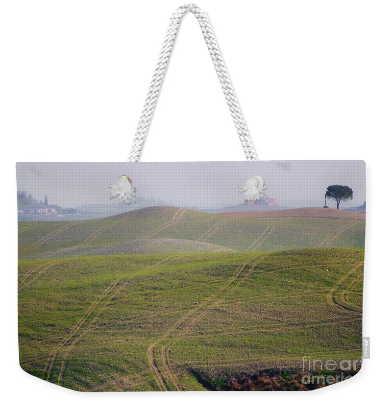 Field Weekender Tote Bag featuring the photograph Tracks On The Field by Mats Silvan