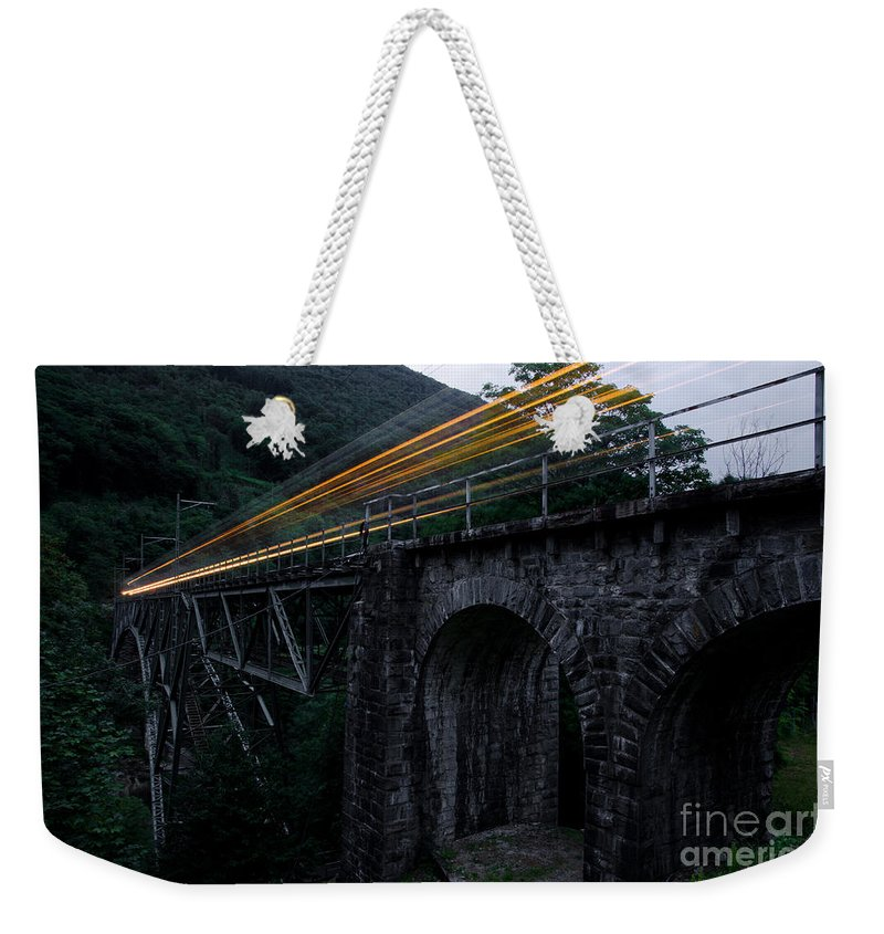 Train Weekender Tote Bag featuring the photograph Train Lights by Mats Silvan