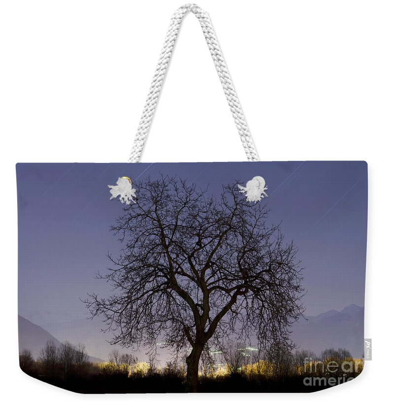 Tree Weekender Tote Bag featuring the photograph Tree At Night With Stars Trails by Mats Silvan