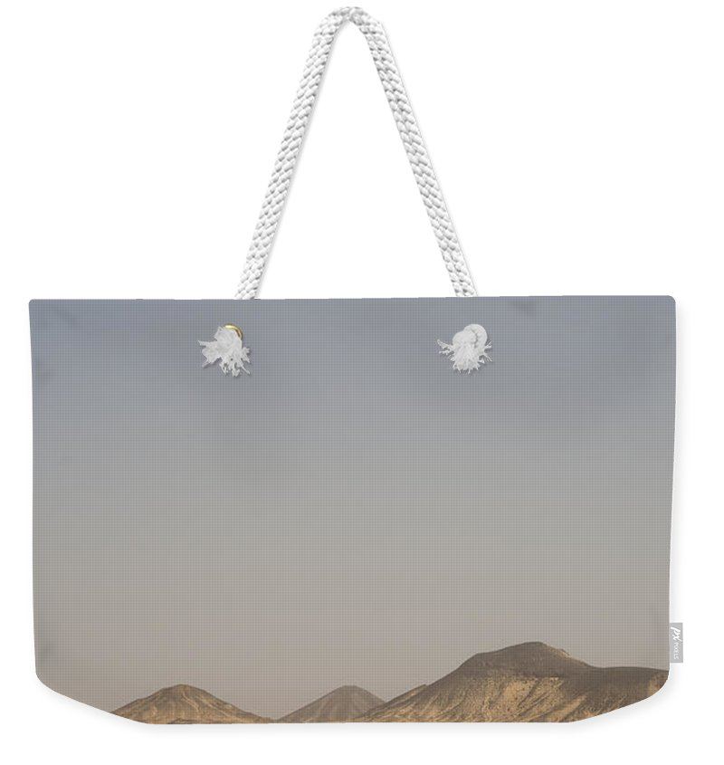 Arid Weekender Tote Bag featuring the photograph Truck Tracks Cut Through The Black by Taylor S. Kennedy