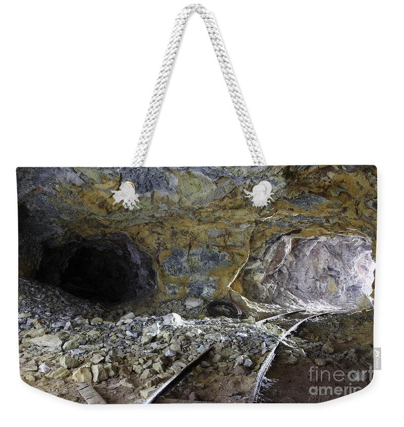 Day Weekender Tote Bag featuring the photograph Tunnel With Abandoned Railtracks by Richard Roscoe