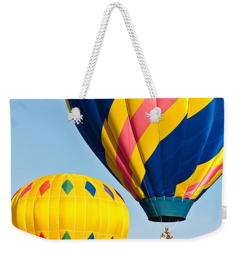 Hot Weekender Tote Bag featuring the photograph Two By Two by Colleen Coccia