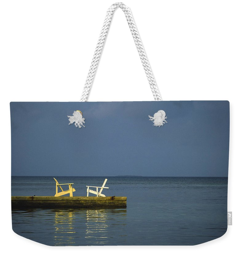 Belize Weekender Tote Bag featuring the photograph Two Deck Chairs In Conversation by Boyd Norton