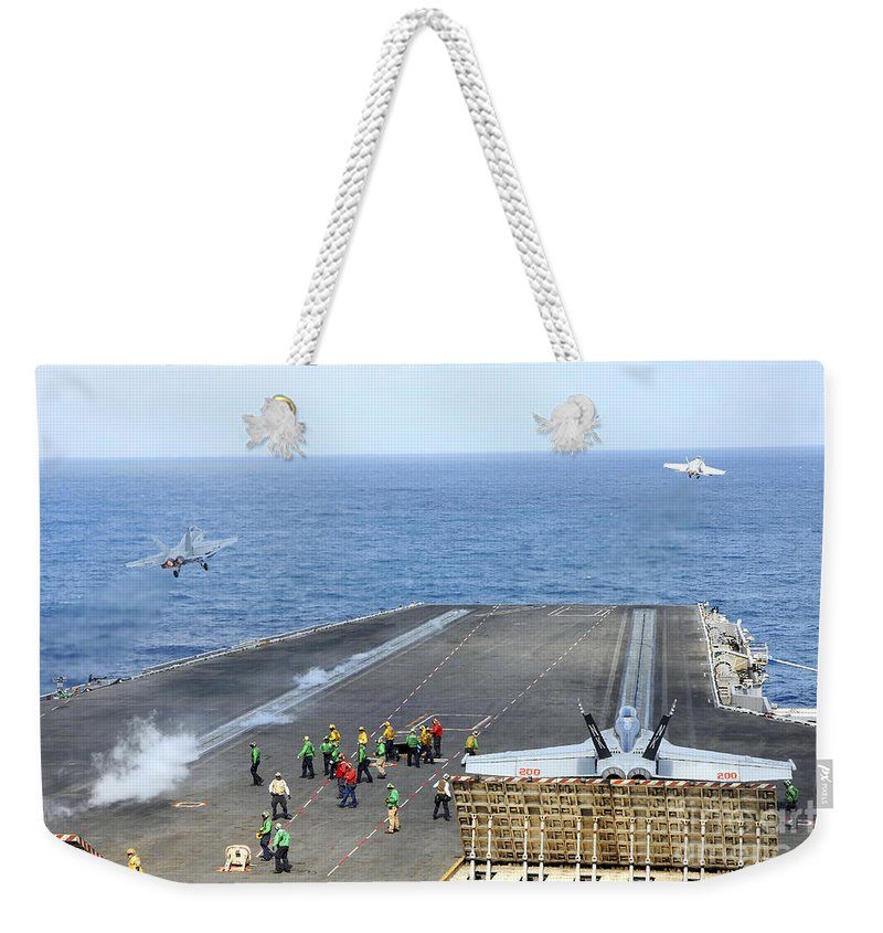 Catapult Weekender Tote Bag featuring the photograph Two Fa-18 Hornets Take by Stocktrek Images