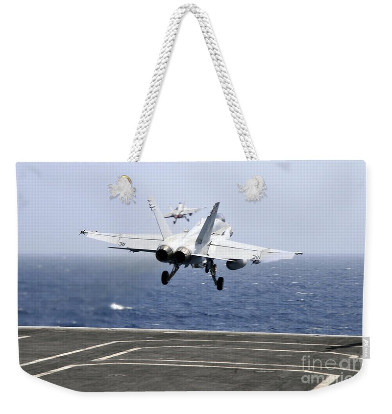 Aircraft Carrier Weekender Tote Bag featuring the photograph Two Fa-18c Hornet Strike Fighters by Stocktrek Images
