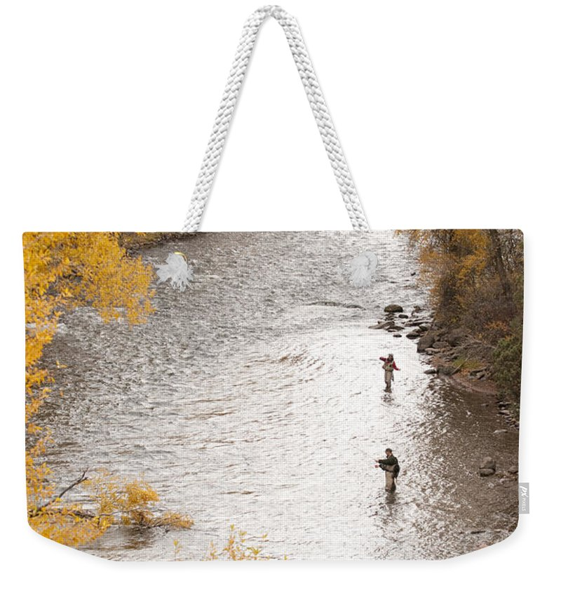 Color Image Weekender Tote Bag featuring the photograph Two Men Flyfishing On The Aspen-lined by Pete Mcbride