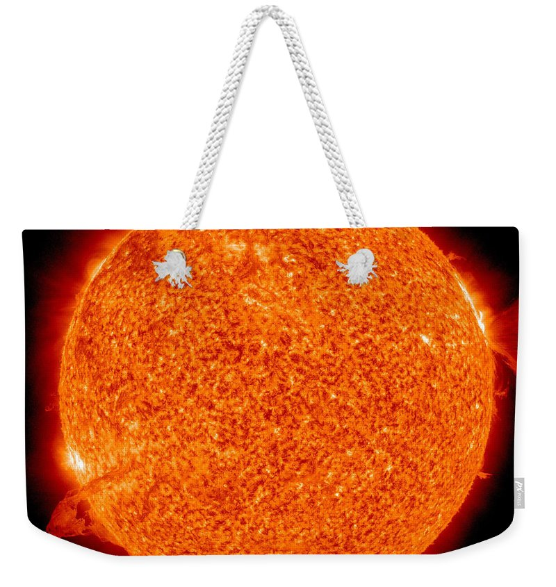 Yellow Dwarfs Weekender Tote Bag featuring the photograph Two Solar Prominences Erupt by Stocktrek Images