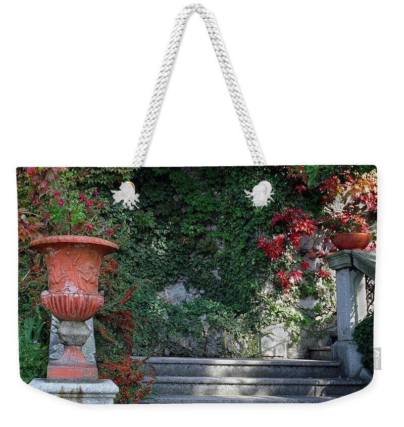 Urn Weekender Tote Bag featuring the photograph Urn And Steps At A Villa On Lake Como by Greg Matchick