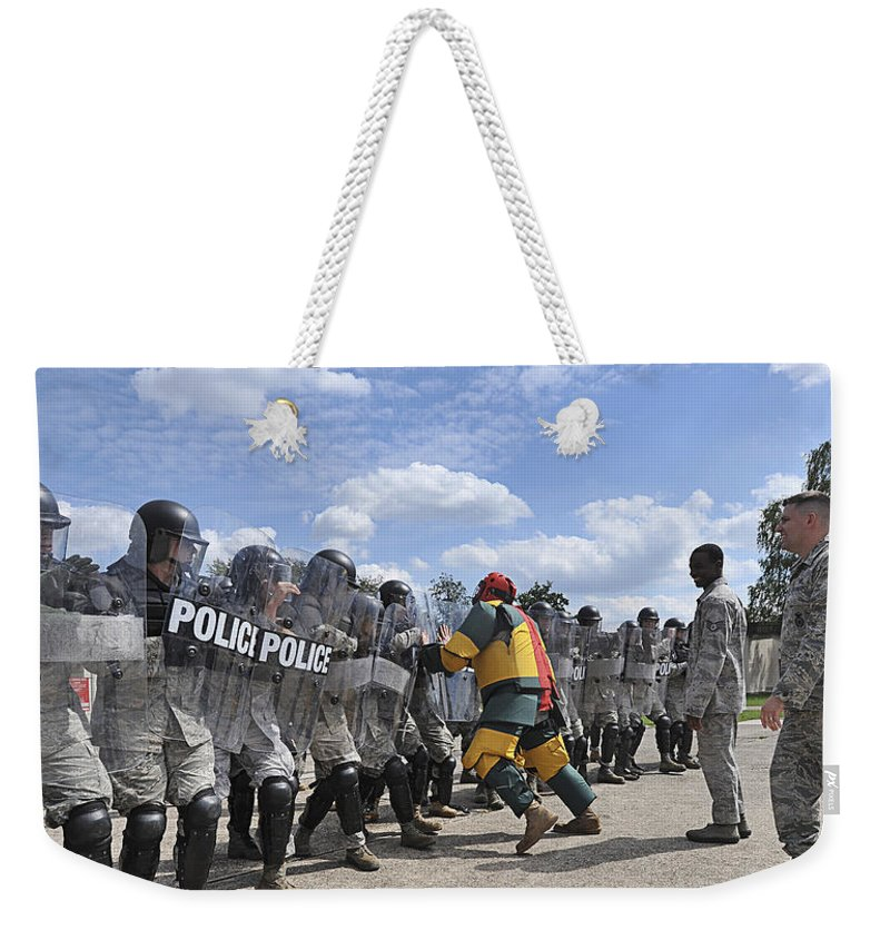 Violence Weekender Tote Bag featuring the photograph U.s. Air Force 86th Security Forces by Stocktrek Images