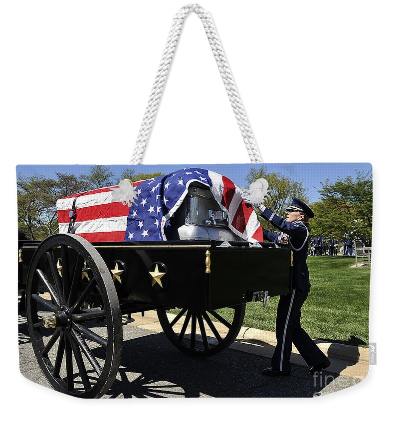 Honor Guards Weekender Tote Bag featuring the photograph U.s. Air Force Honor Guard Straightens by Stocktrek Images