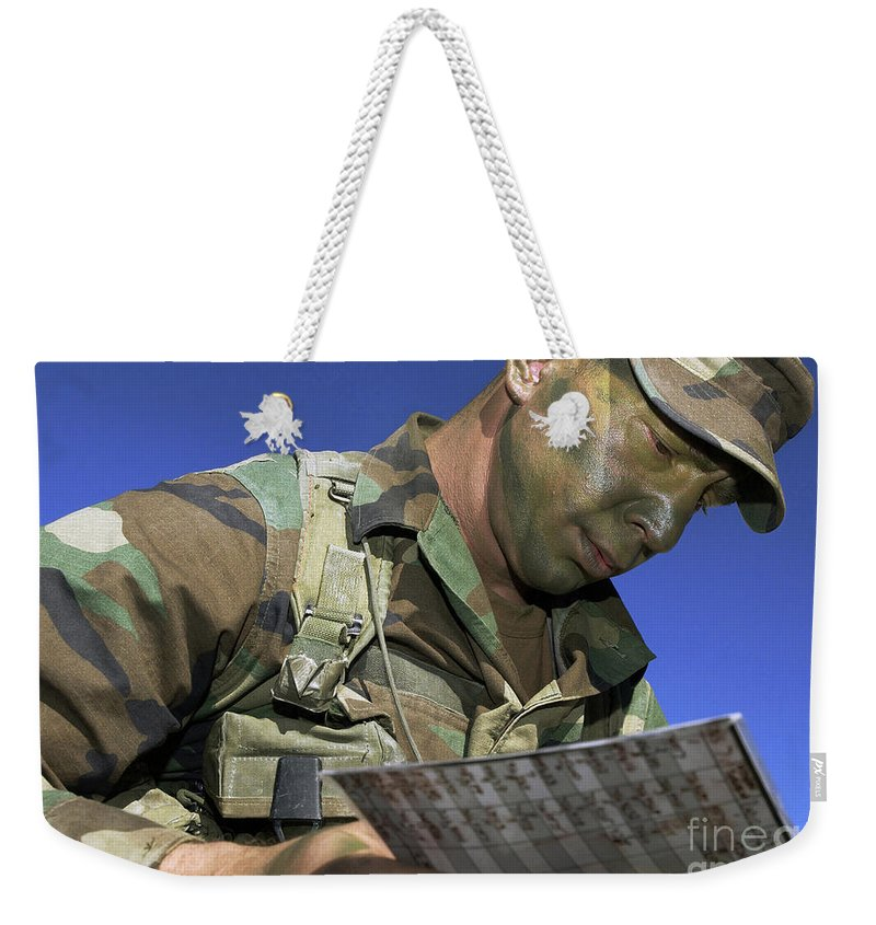 Military Weekender Tote Bag featuring the photograph U.s. Air Force Lieutenant Reviews by Stocktrek Images