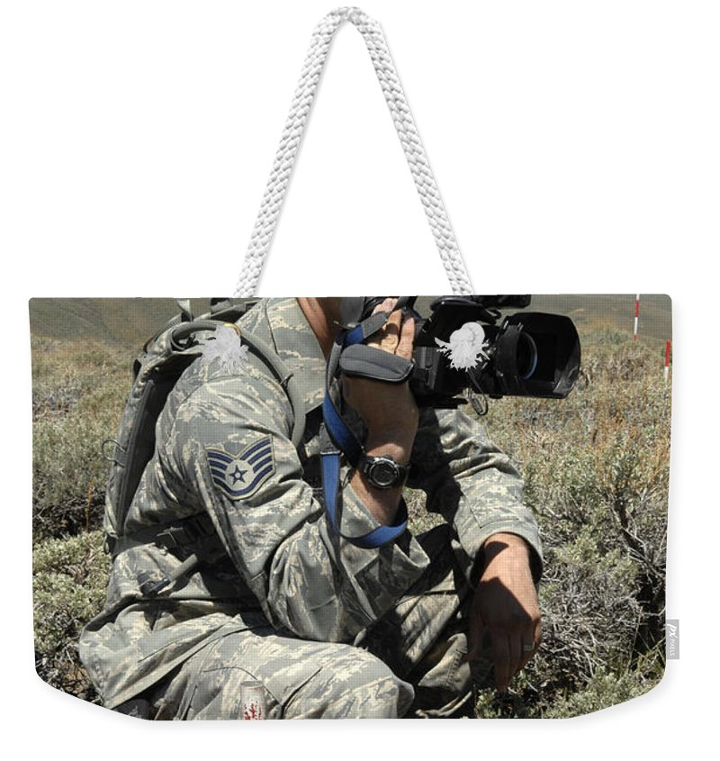 Us Air Force Weekender Tote Bag featuring the photograph U.s. Air Force Sergeant Shoots Video by Stocktrek Images
