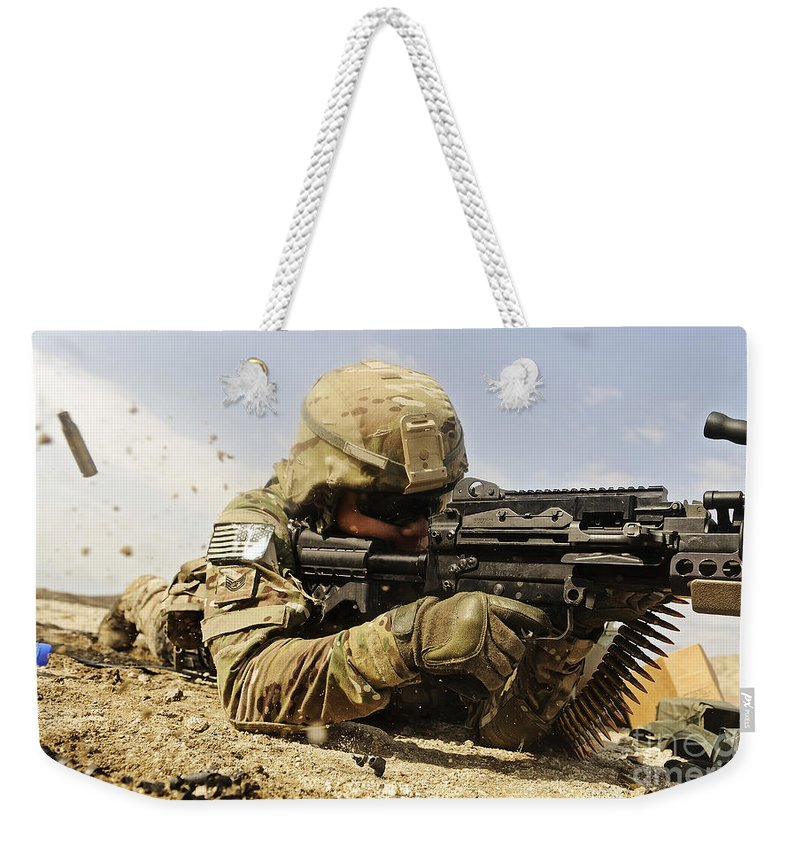 Security Forces Weekender Tote Bag featuring the photograph U.s. Air Force Soldier Fires The Mk48 by Stocktrek Images