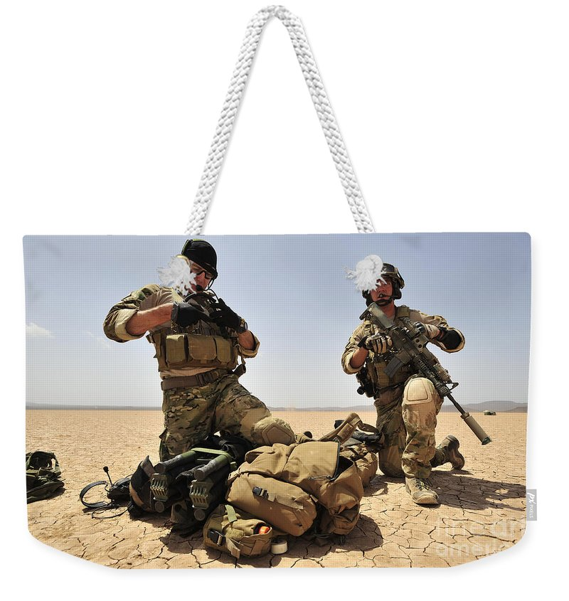 Djibouti Weekender Tote Bag featuring the photograph U.s. Air Force Soldiers Gather by Stocktrek Images