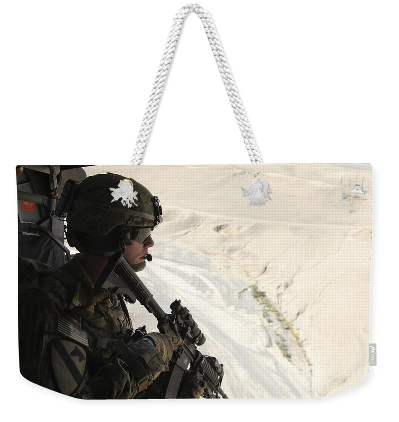 Afghanistan Weekender Tote Bag featuring the photograph U.s. Army Captain Looks Out The Door by Stocktrek Images