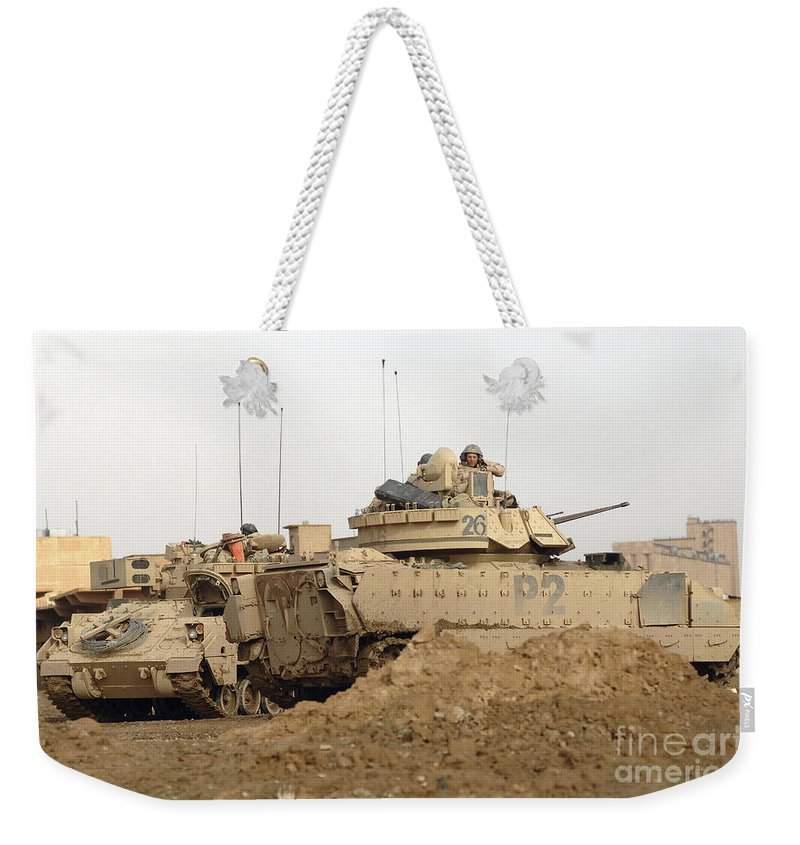 Turret Weekender Tote Bag featuring the photograph U.s. Army M2 Bradley Infantry Fighting by Stocktrek Images