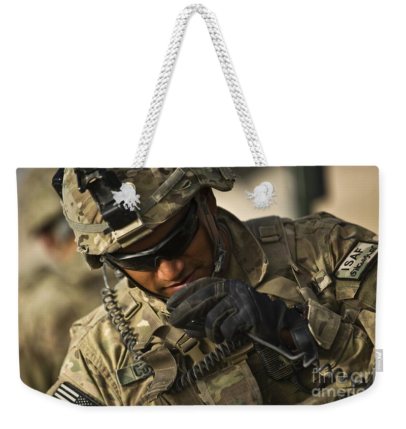 Strategy Weekender Tote Bag featuring the photograph U.s. Army Soldier Communicates by Stocktrek Images