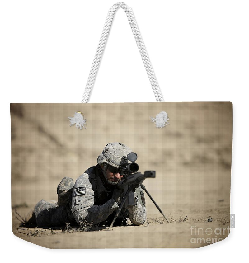 Operation Enduring Freedom Weekender Tote Bag featuring the photograph U.s. Army Soldier Sights In A Barrett by Terry Moore