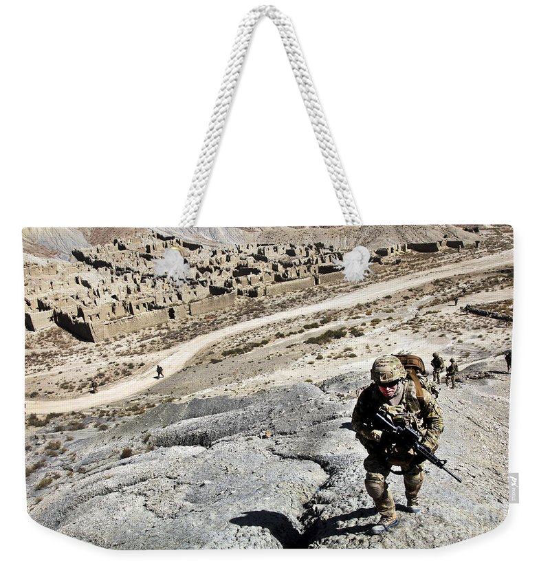Operation Enduring Freedom Weekender Tote Bag featuring the photograph U.s. Army Soldiers And Afghan Border by Stocktrek Images