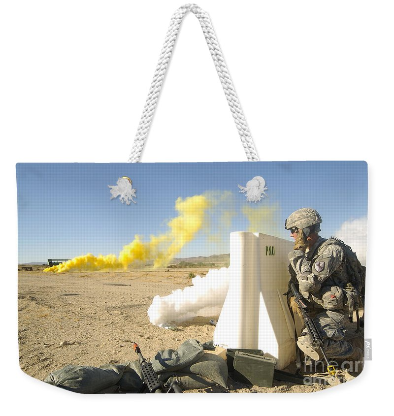 Communication Weekender Tote Bag featuring the photograph U.s. Army Specialist Calls In For An by Stocktrek Images