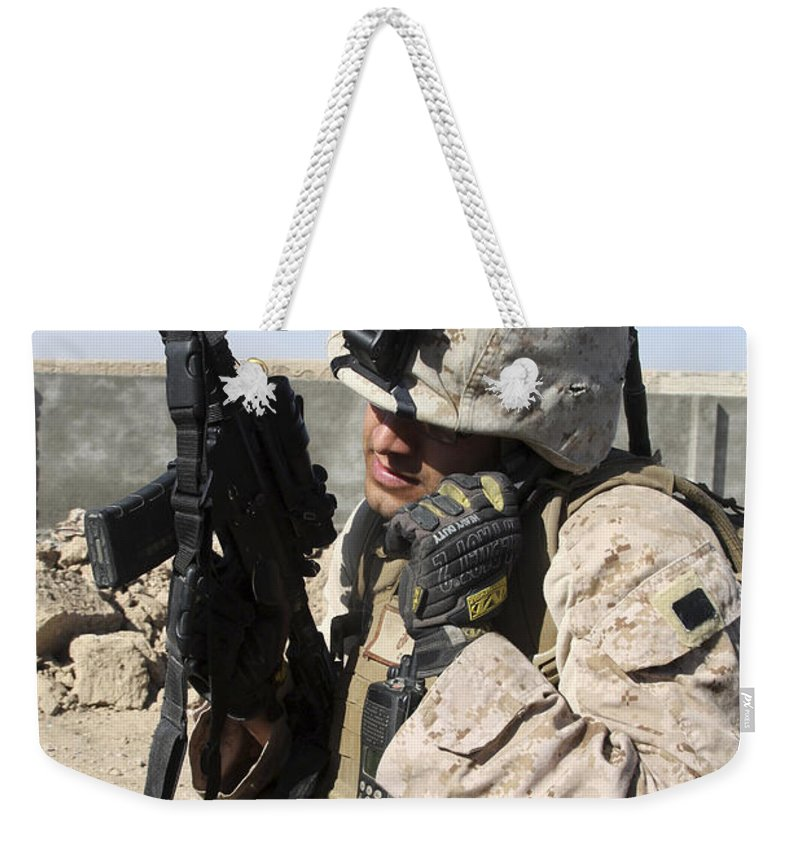 Middle East Weekender Tote Bag featuring the photograph U.s. Marine Communicates With Fellow by Stocktrek Images