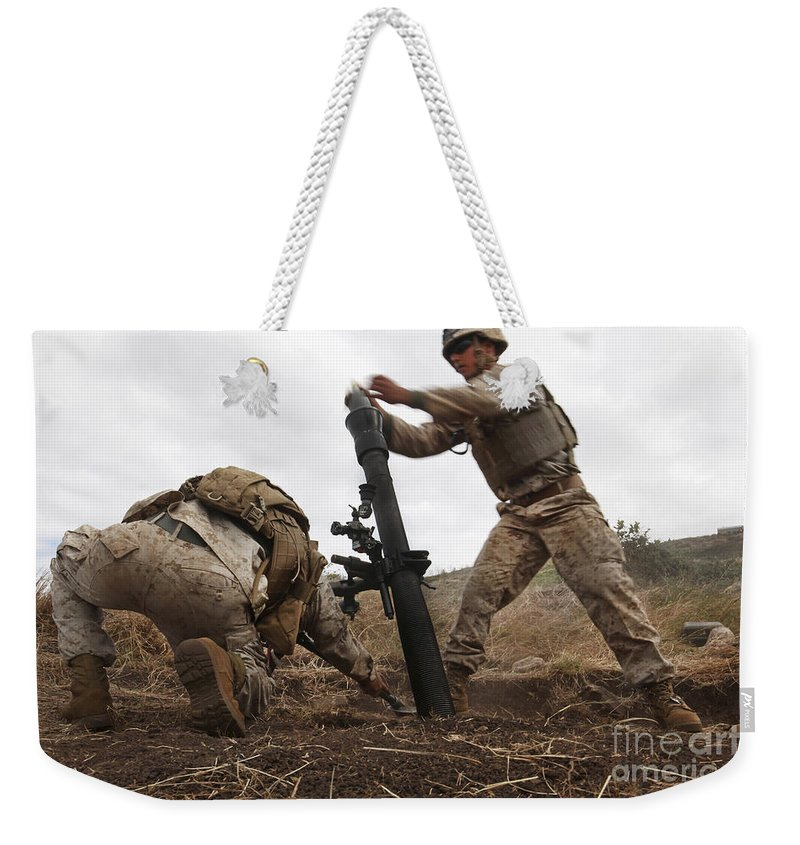 Bending Over Weekender Tote Bag featuring the photograph U.s. Marine Drops A Mortar Round by Stocktrek Images