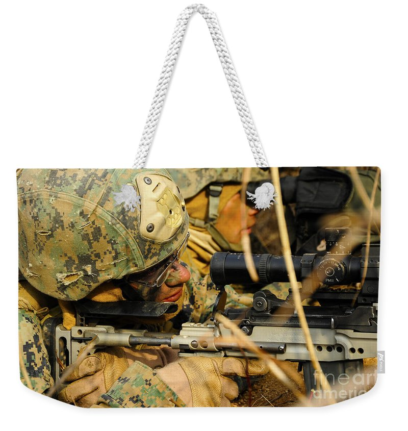 Us Marine Corps Weekender Tote Bag featuring the photograph U.s. Marine Uses A Spotting Scope by Stocktrek Images