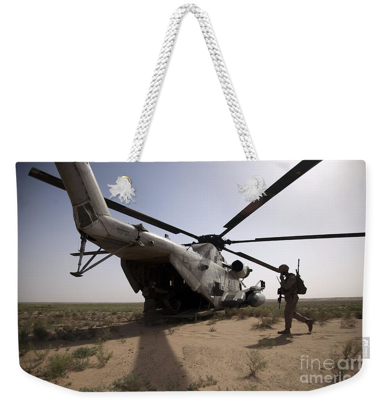 Operation Enduring Freedom Weekender Tote Bag featuring the photograph U.s. Marines Board A Ch-53d Sea by Stocktrek Images